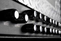 Black musical guitar amplifier panel Stock Image