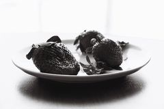 Stale musty strawberries black and white royalty free stock photography