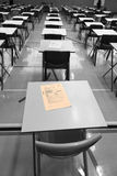 Black n White exam dread. Your exam paper is the only thing to stand out as you enter the exam hall in this bleak B&W setting Stock Photos