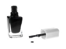 Black nail polish with brush dripping Stock Photo