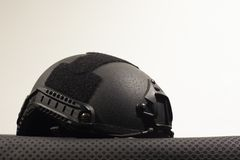Black nato military helmets on white background. Black Nato military helmet on white background made of booletproof kevlar for better use stock images