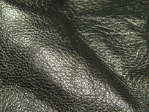Black natural leather. Black natural sheep lather textures Royalty Free Stock Photo