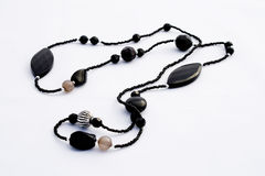 Black necklace isolated Stock Images