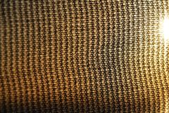 Black Netting. A background of a black netting texture with sun flare stock images