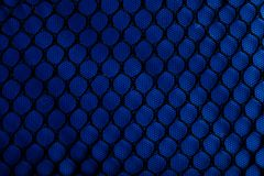 Black netting over blue fabric Royalty Free Stock Images
