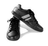 Black new sneakers isolated on white background. Black new sneakers close up isolated on white background Stock Photos