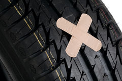 Black new tire with patch on white Royalty Free Stock Image