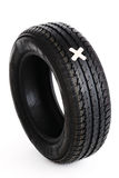 Black new tire with patch on white Stock Photos
