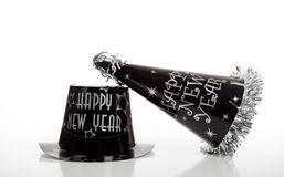 Black new year's eve hat on white Stock Photos