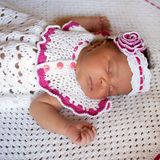 Black newborn baby in knitted sleeping Royalty Free Stock Photography