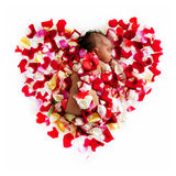 Black newborn baby sleeping in flowers. Royalty Free Stock Photography