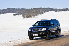 Black Nissan Pathfinder near lake Baikal. Enkheluk, Buryat Republic, Russia - February 21, 2012: black Nissan Pathfinder near lake Baikal Royalty Free Stock Photos