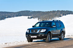 Black Nissan Pathfinder near lake Baikal. Enkheluk, Buryat Republic, Russia - February 21, 2012: black Nissan Pathfinder near lake Baikal Royalty Free Stock Image