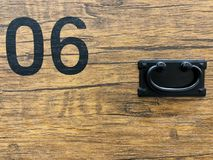 Black No.06 paint on wooden black ground. Vintage style royalty free stock image