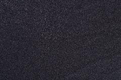 Black nonwoven fabric background Royalty Free Stock Photo