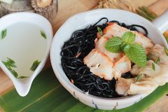 black noodles with pork and dumpling delicious Stock Photo