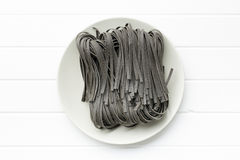 Black noodles with squid sepia ink Royalty Free Stock Image
