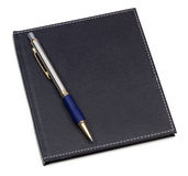 Black note book with ballpoint pen Royalty Free Stock Images