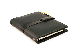 Black note book with ballpoint pen Stock Photos