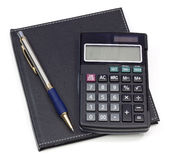 Black note book calculator and pen Royalty Free Stock Photos