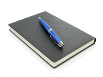 Black notebook with blue pen. On a white background Stock Photos