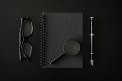 Black notebook with copyspace on black background Royalty Free Stock Image