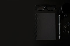 Black notebook with copyspace and cup of coffee Royalty Free Stock Photos
