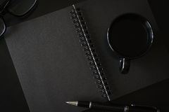 Black notebook with copyspace and cup of coffee Royalty Free Stock Images