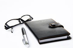 Black notebook and glasses Royalty Free Stock Photo