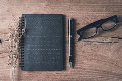 Black notebook on old wooden background Royalty Free Stock Photography