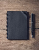 Black notebook on old wooden background Royalty Free Stock Image