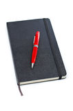 Black notebook and pen Stock Photo