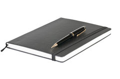 Black notebook and pen. Over a white background Stock Images