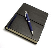 Black notebook with pen Royalty Free Stock Photo