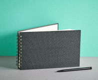 Black notebook and pen Royalty Free Stock Images