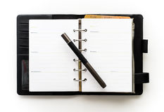 Black notebook and pen Royalty Free Stock Photography