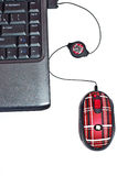 Black notebook with red mouse. Black notebook and red computer mouse Royalty Free Stock Photos