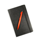 Black Notebook and Red Pen on White Stock Photo