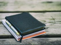 Black Notebook Beside Silver and Gold Pen Stock Photo