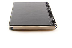 Black notebook on a white background Stock Photos