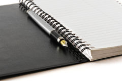 Black notebook on a white background Stock Photo