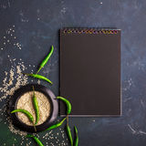 Black notepad for recording recipes, menus, timetables for Asian-style cafes in dark colors. Top View Royalty Free Stock Photography