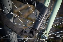 Number lock on a bicycle to prevent theft. Black number combination lock on a bicycle to prevent theft Stock Photography