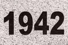 Numbers 1942 on a marble slab. Black numbers figures 1942 on a marble slab Stock Photo