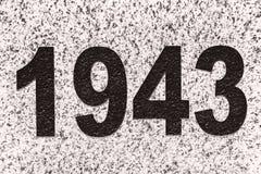 Numbers figures 1943 on a marble slab. Black numbers figures 1943 on a marble slab Stock Image