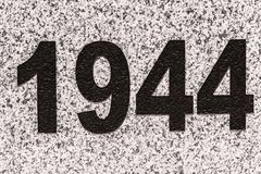 Numbers 1944 on a marble slab. Black numbers figures 1944 on a marble slab Stock Photography