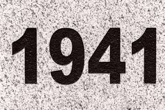 Numbers figures 1941 on a marble slab. Black numbers 1941 on a grey marble slab. 1941 year the date of the beginning of the Great Patriotic War Stock Photos