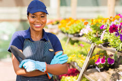 Black nursery worker greenhouse Royalty Free Stock Photos