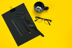Black objects from the office on a yellow background. Work and creativity. Top view. Black objects from the office on a yellow background. Work and creativity royalty free stock image