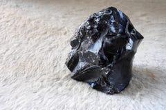 Black obsidian stone. Volcano lava. Stock Image